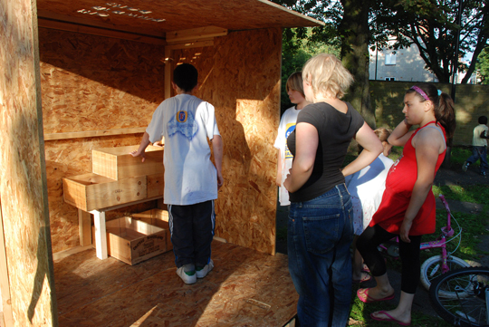 arranging shelves inside the drawing shed